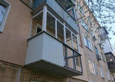 фото пластиковый балкон обшитый профнастилом в Донецке ремонт балкона Окна Prof 009