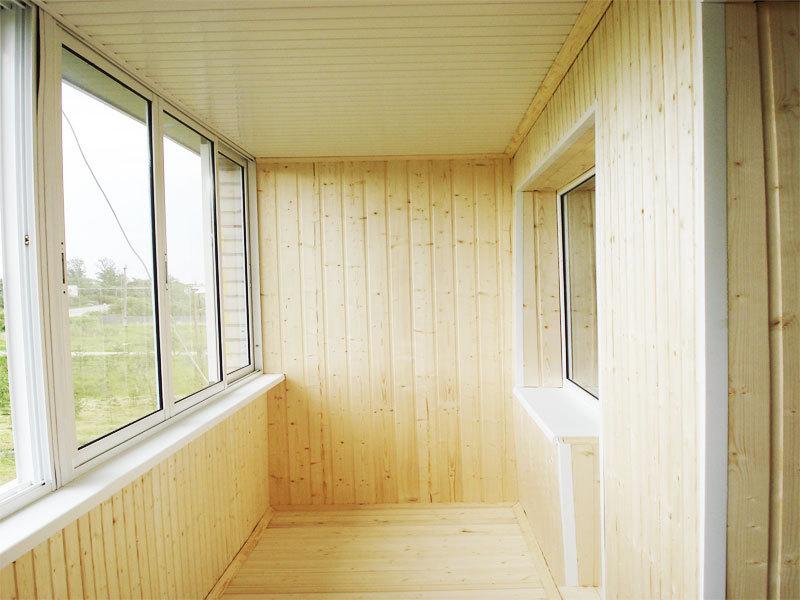 Отделка балкона имитацией бруса