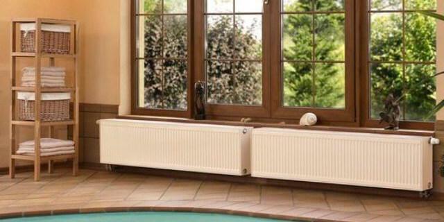 картинка низкие батареи отопления для панорамных окон